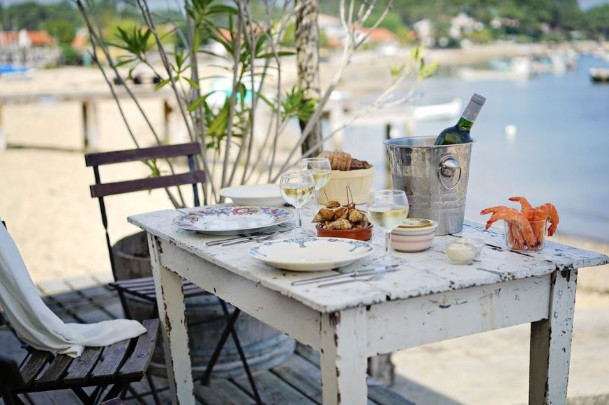 Seaside picnic with bordeaux wine