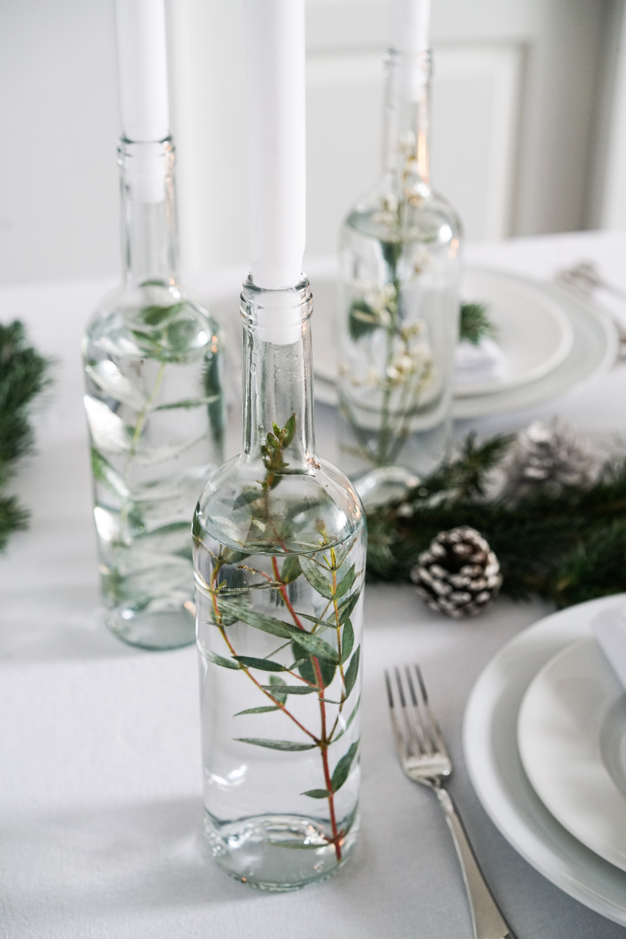 Why not try wrapping the candles (preferably ones of large diameter) with leftover foliage, fallen branches from the trees or herbs like rosemary or thyme.